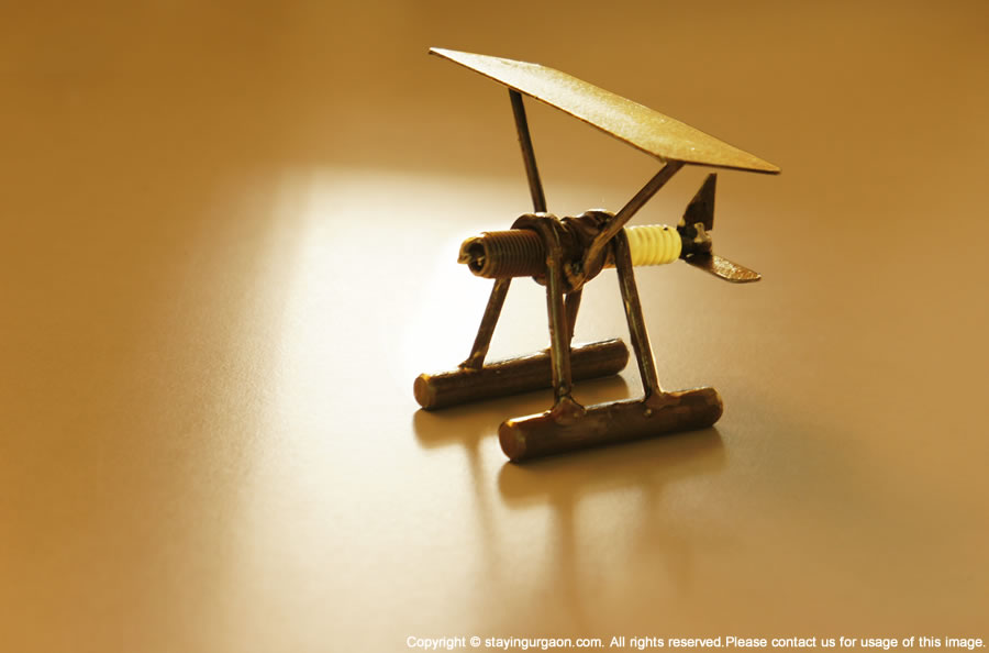 Recycled Auto Art: Recycled Spark Plug Paper Weight - Glider