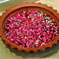 An urli with fresh flowers - Naivedyam
